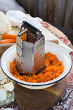Grater and carrots Stock Photo