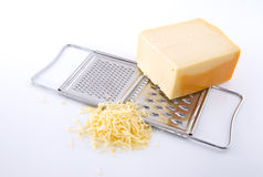 Grater with cheese. On a white background stock images