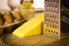 Grater with cheese Royalty Free Stock Image