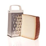 Grater and Cheese isolated on white Stock Image