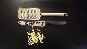 Grater cheese and knife. How to deal with cheese in style Stock Photography