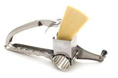 Grater and cheese on white Royalty Free Stock Photography