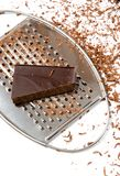 Grater with chips of chocolate on it Stock Images