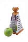Grater e maçã Fotografia de Stock Royalty Free