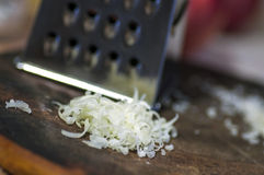 Grater and grated cheese Royalty Free Stock Image