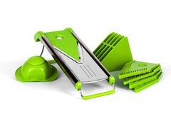 Grater with green nozzles and holder of vegetables Royalty Free Stock Photos