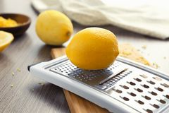 Grater and lemons. On kitchen table Royalty Free Stock Photos