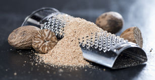 Grater with Nutmegs Stock Photography