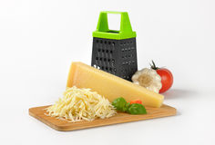 Grater and parmesan cheese Stock Photo