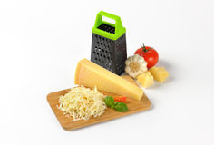 Grater and parmesan cheese Stock Photos