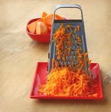 A grater and pieces of pumpkin Royalty Free Stock Images