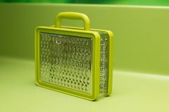 Grater plastic grind food green. Suitcase closed Stock Photos