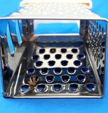 Grater. Small grater of food, metallic, seen from another perspective stock photo