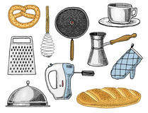 Grater and whisk, frying pan, Turk for coffee, cup of tea, mixer and baked loaf Royalty Free Stock Photography