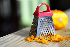 Grater zest of citrus fruit and on wooden table. Grater zest of citrus fruit and on the wooden table Royalty Free Stock Photos