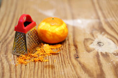 Grater zest of citrus fruit and on wooden table. Grater zest of citrus fruit and on the wooden table Royalty Free Stock Photo
