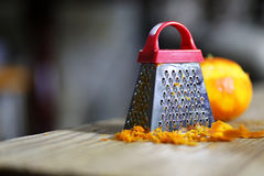 Grater zest of citrus fruit and on wooden table. Grater zest of citrus fruit and on the wooden table Stock Photos