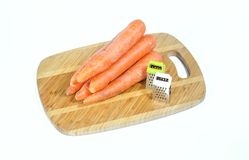 Graters and carrots Stock Images