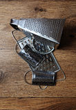 Graters. Few different steel graters for using in the kitchen royalty free stock photo