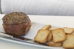 Gratin сыра заполненный с ветчиной и сопровоженный с здравицами Стоковые Фото