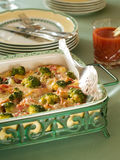 Gratin. Broccoli and ham gratin in baking pot, selective focus royalty free stock images