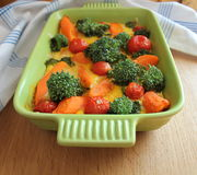 Gratin with broccoli,cherry tomatoes and carrots Stock Photo
