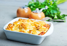 Gratin. With cauliflower and cheese on a table stock photos