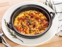 Gratin dei frutti di mare con bacon e formaggio Immagini Stock Libere da Diritti