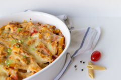 Gratin with pasta and cheese. In white casserole Stock Photography