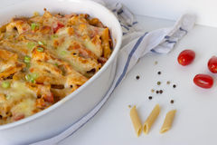 Gratin with pasta and cheese. In white casserole Stock Photo