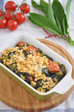 Gratin with spinach. Red lentils and wild garlic royalty free stock image