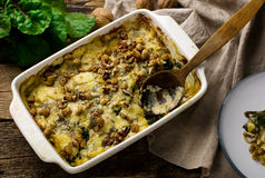 Gratin from a swiss chard with cheese and walnut. Royalty Free Stock Image