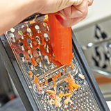 Grating a carrot Stock Photos