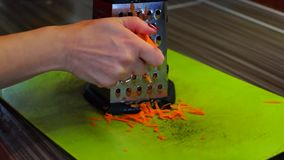 Grating the carrots on grater stock video footage