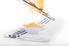 Grating cheese. Royalty Free Stock Image
