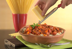 Grating Cheese over Spaghetti Bolognaise Stock Photography