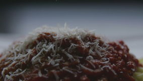 Grating cheese on spaghetti time lapse stock video