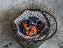 Grating on  clay stove. For traditional cooking in Thailand Stock Photos