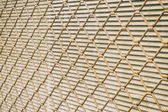 Grating covering a window Royalty Free Stock Image