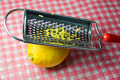 Grating fresh whole lemon Stock Photos