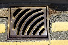 Grating gully manhole metal old road sewer Royalty Free Stock Photography