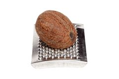 Grating nutmeg Stock Photo
