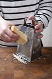 Grating Parmesan Cheese Royalty Free Stock Photography