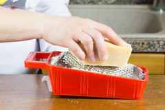 Grating Parmesan cheese Stock Images
