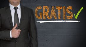 Gratis in german free of charge concept and businessman with. Thumbs up stock image