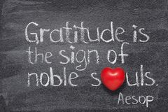 Gratitude is Aesop. Gratitude is the sign of noble souls - quote of ancient Greek story teller Aesop written on chalkboard with red heart instead of O royalty free stock images