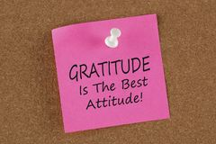 Gratitude Is The Best Attitude written on remember note concept. On a cork board.Business Concept Stock Photo