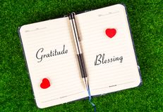 Gratitude equal Blessing. Gratitude and Blessing word on both sides of the notebook in the concept of equal Stock Photo