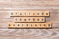 Gratitude changes everything word written on wood block. Gratitude changes everything text on wooden table for your desing, royalty free stock photos