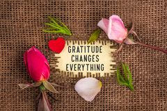 Free Gratitude Changes Everything Written In Hole On The Burlap Stock Photography - 132271872